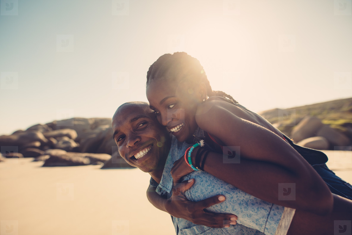 Young african couple enjoying at the beach