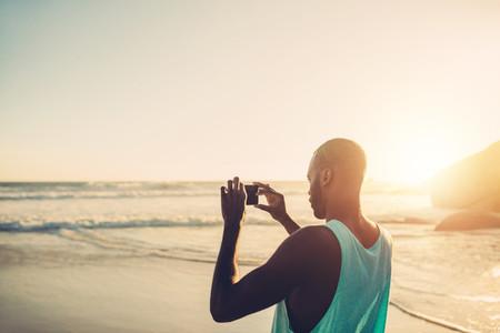 Afro american man taking photo