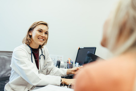 Female doctor listening to her patient during consultation