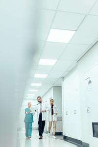 Medical team in hospital corridor discussing work