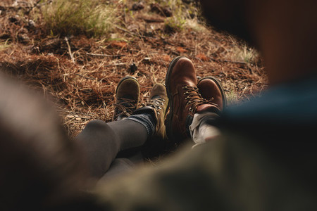 Couple of hikers sitting together outdoors