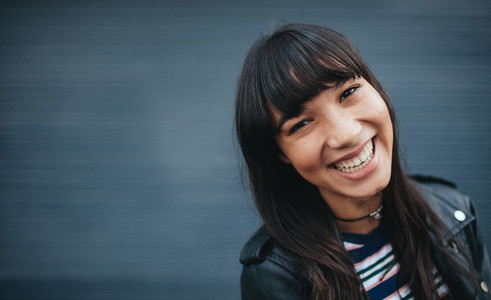 Close up of beautiful smiling young woman