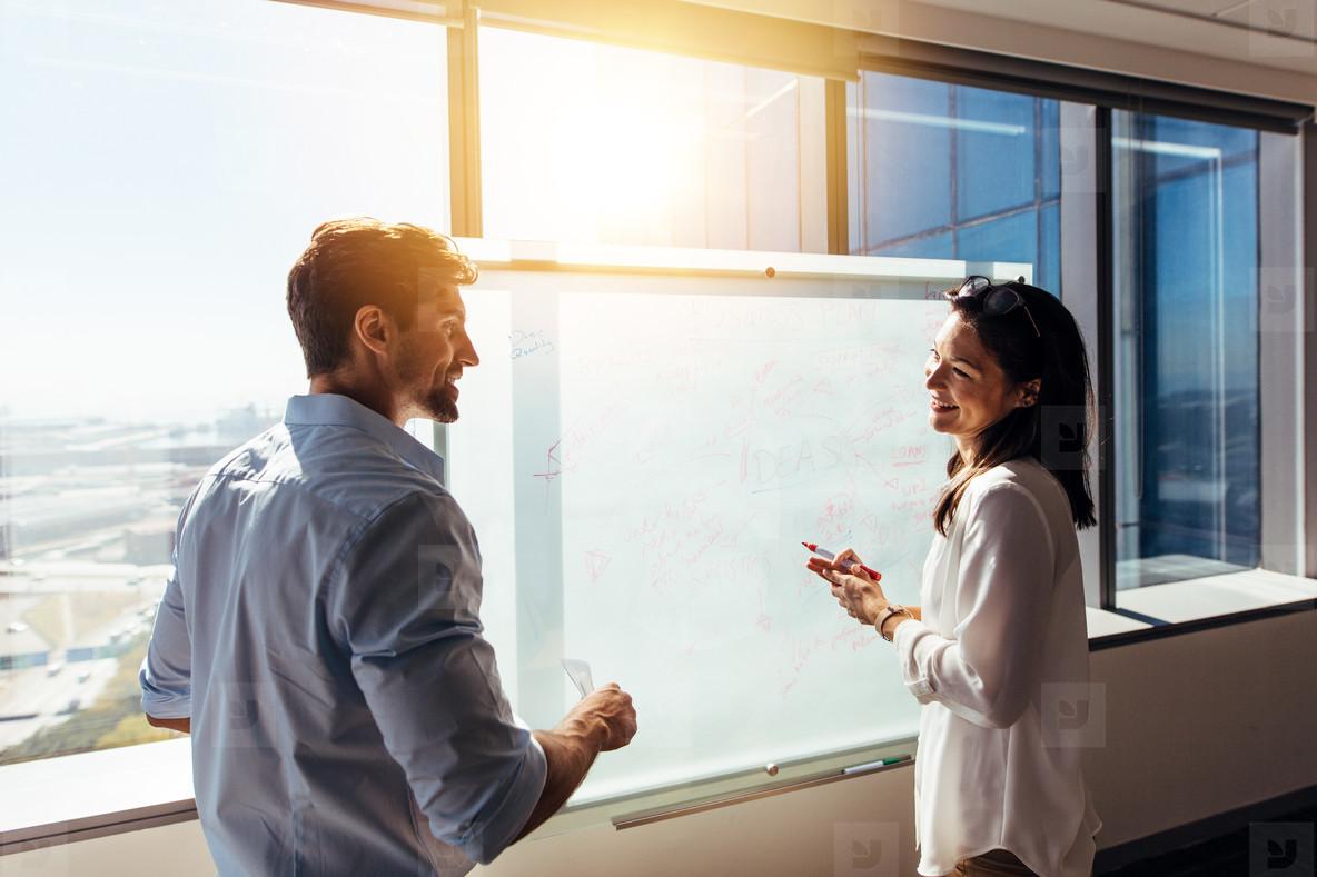 Business investors in boardroom discussing work