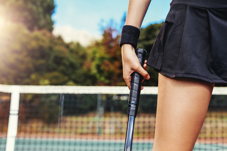 Woman holding a tennis racket at the court