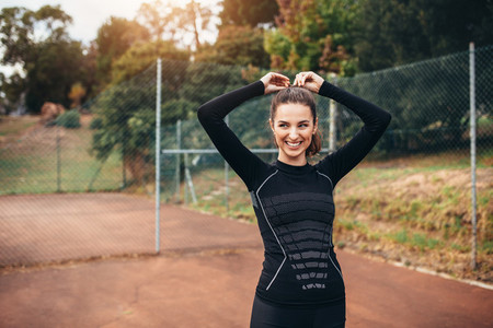 Sporty woman smiling outdoors