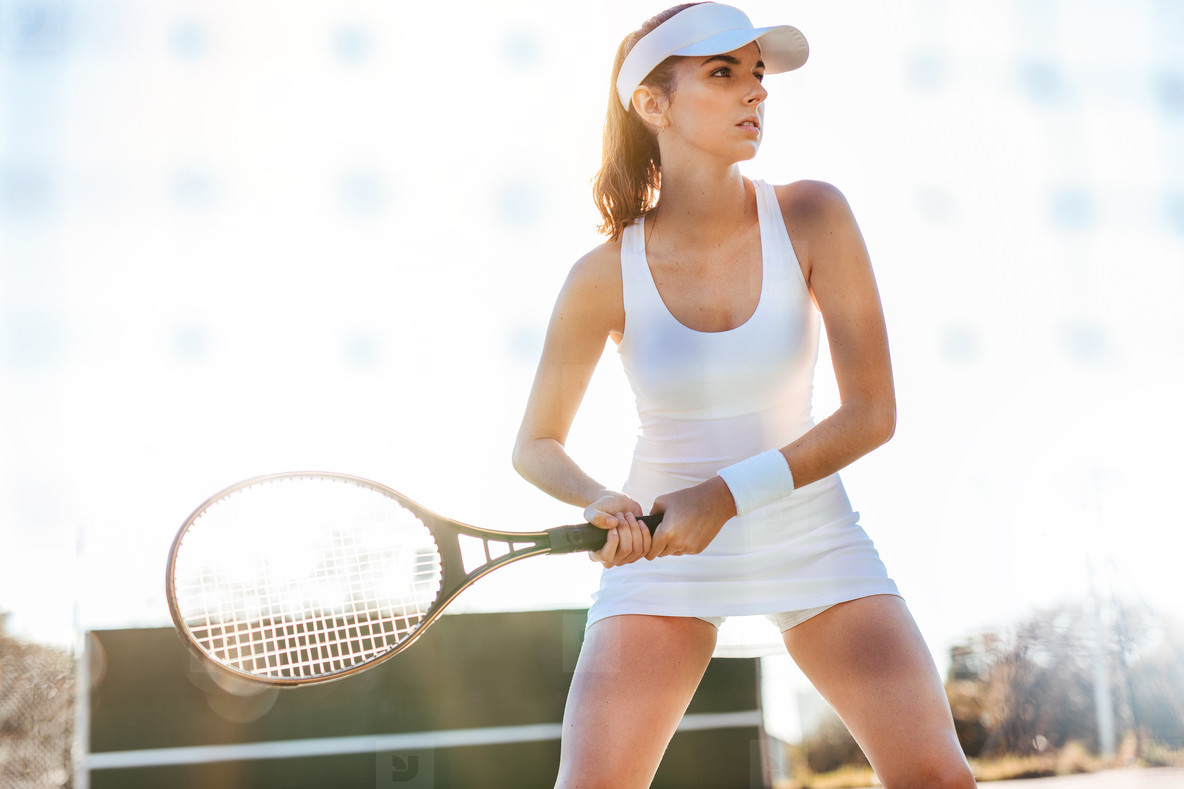 Female tennis player playing match on court
