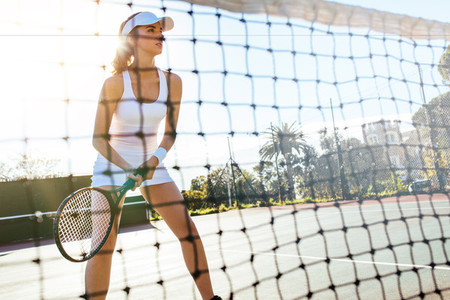 Tennis player playing match on a sunny day