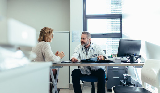Doctor with patient during consultation in medical office
