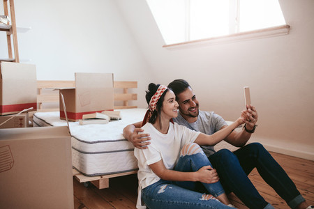 Couple moving in new place and making a selfie