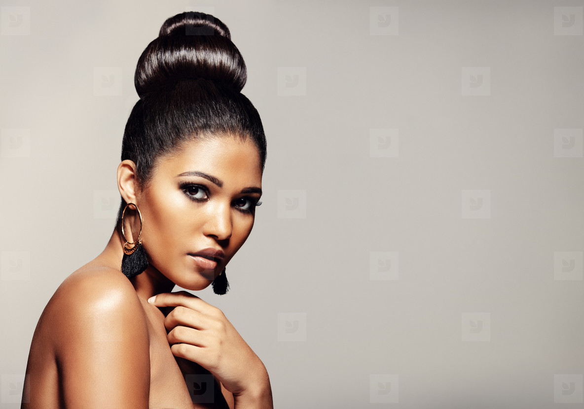 Woman with elegant hairstyle and makeup