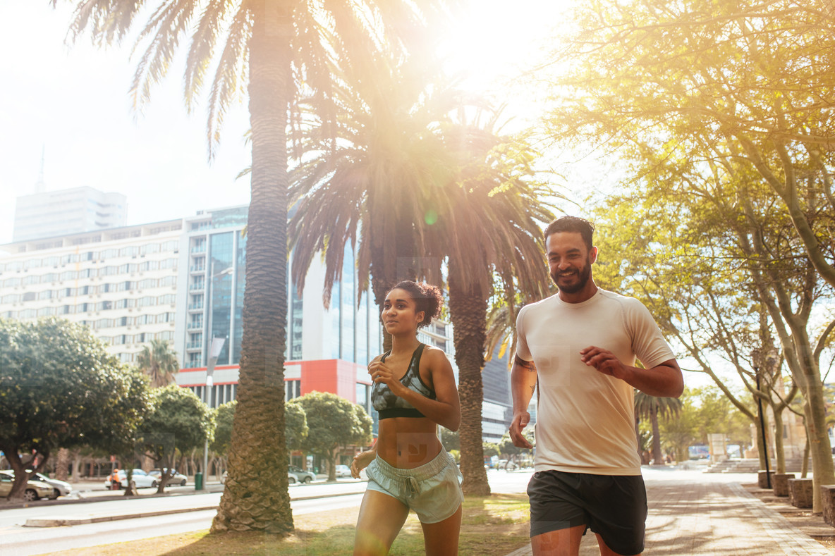 Couple jogging in city