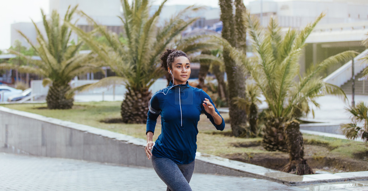Woman running on street