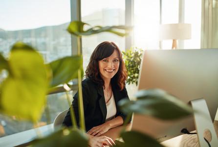 Smiling female designer at her workplace