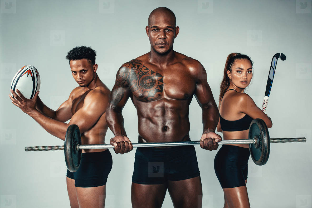 Three young fitness people with sports equipments
