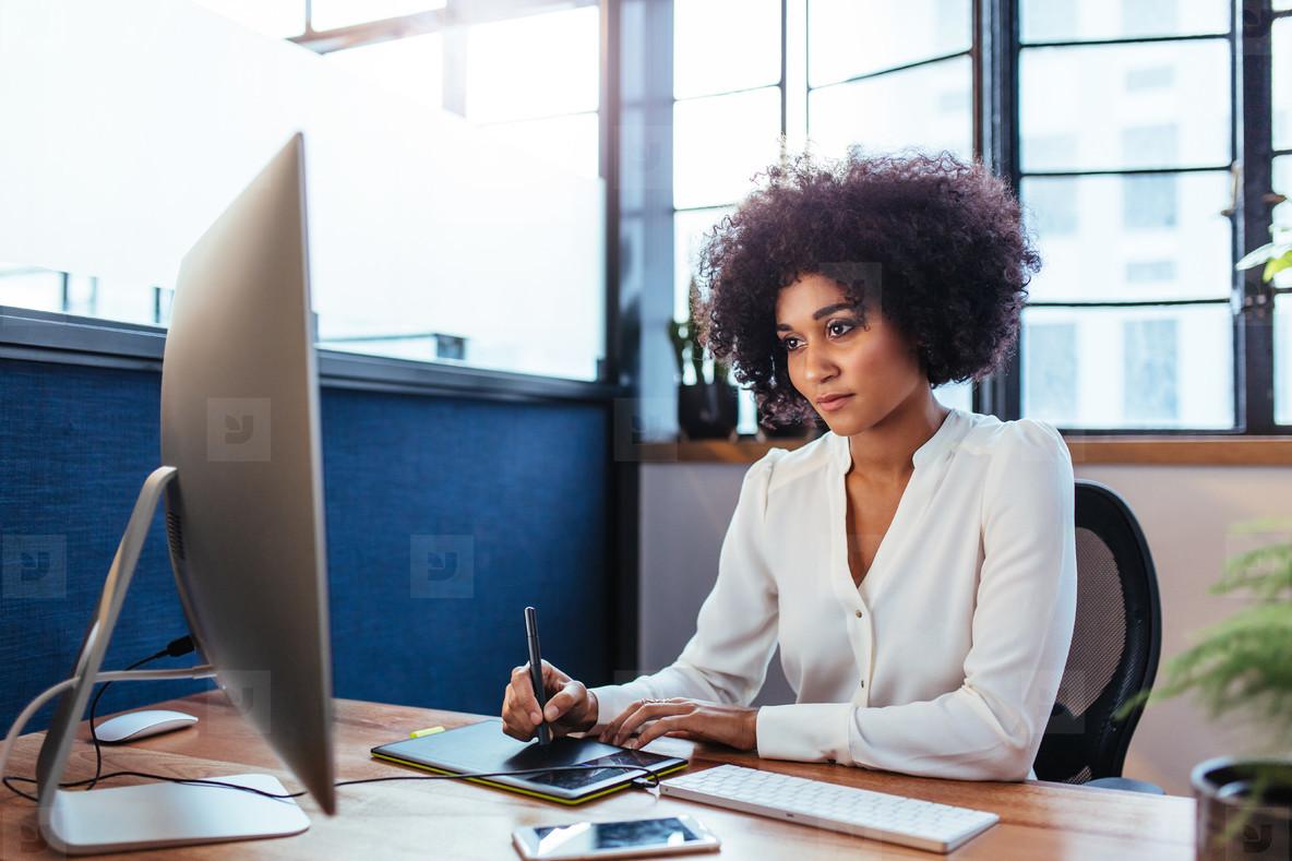 Female designer working in office