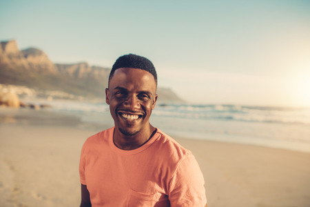 Afro american man smiling at the beach