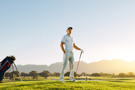 Caucasian male golfer standing on golf course