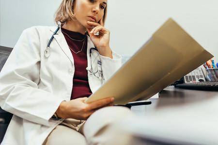 Doctor reading medical documentation in hospital
