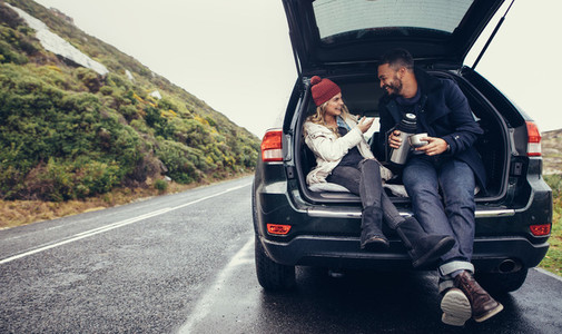 Couple having a coffee break during road trip