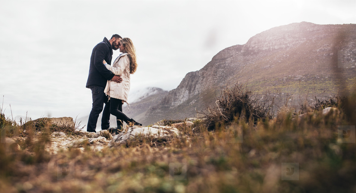 Romantic couple kissing in the nature