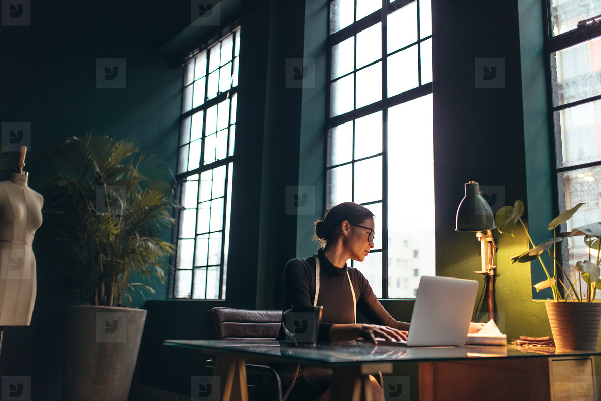 Female fashion designer working in her office