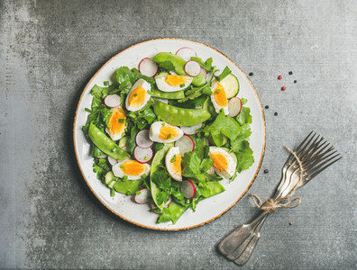 Healthy spring green salad with vegetables  pea and boiled egg