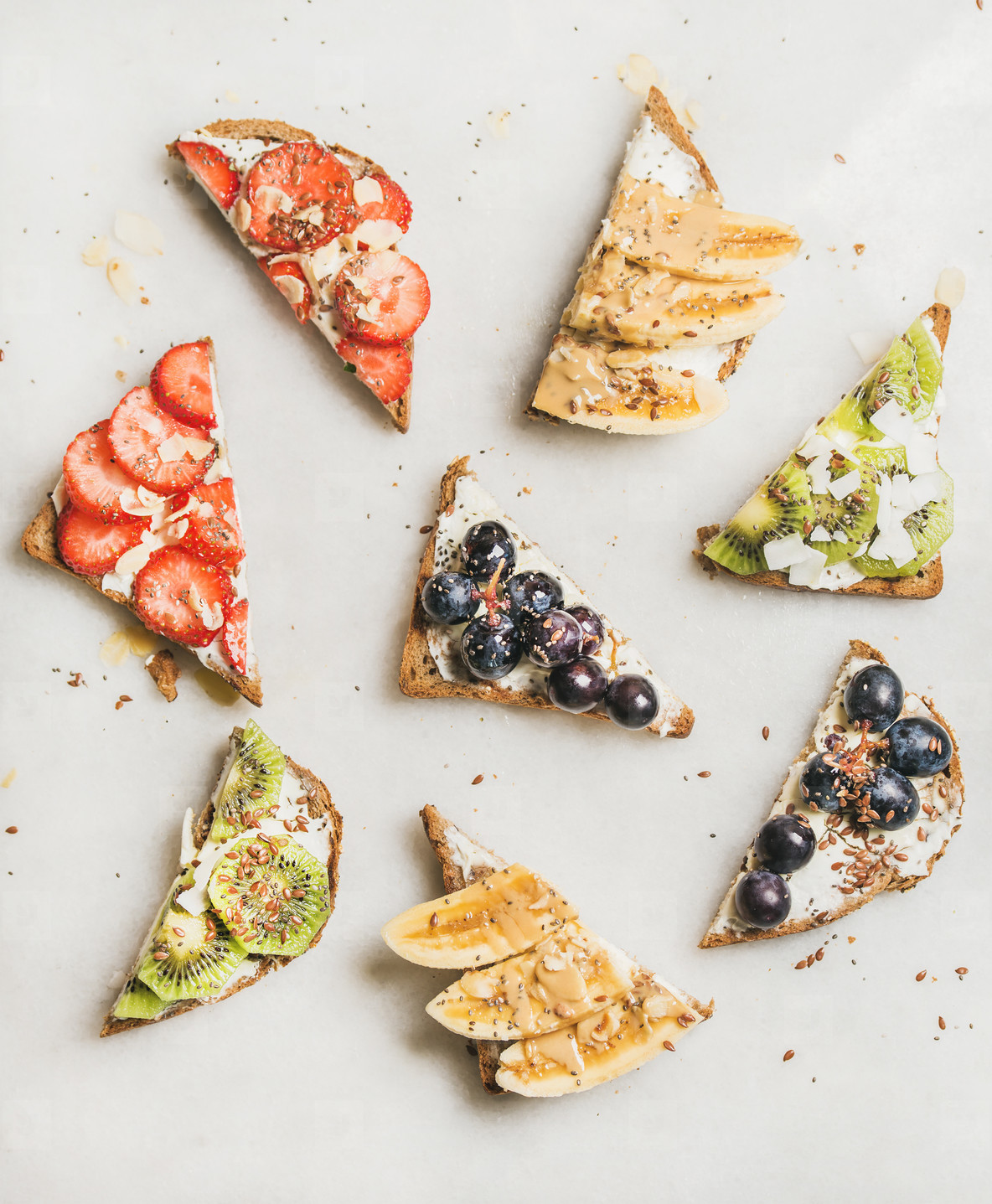 Healthy breakfast toasts with fruit  nuts  seed and cream cheese