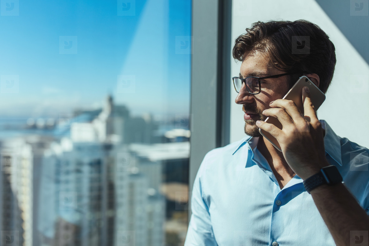 Closeup of a business investor talking on phone