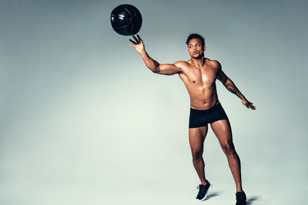 African male workout with a medicine ball