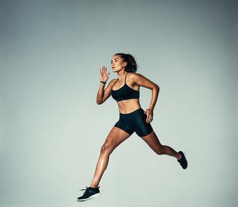 Female athlete doing running exercise