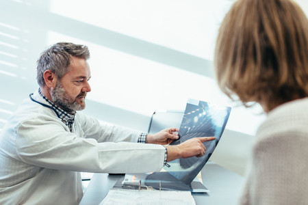 Doctor discussing medical scan results with patient