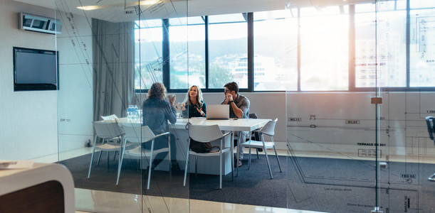 Three designers discussing in meeting hall