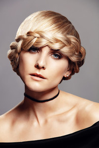 Beautiful blonde woman with braid hairdo
