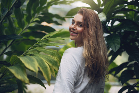 Attractive young woman in greenhouse