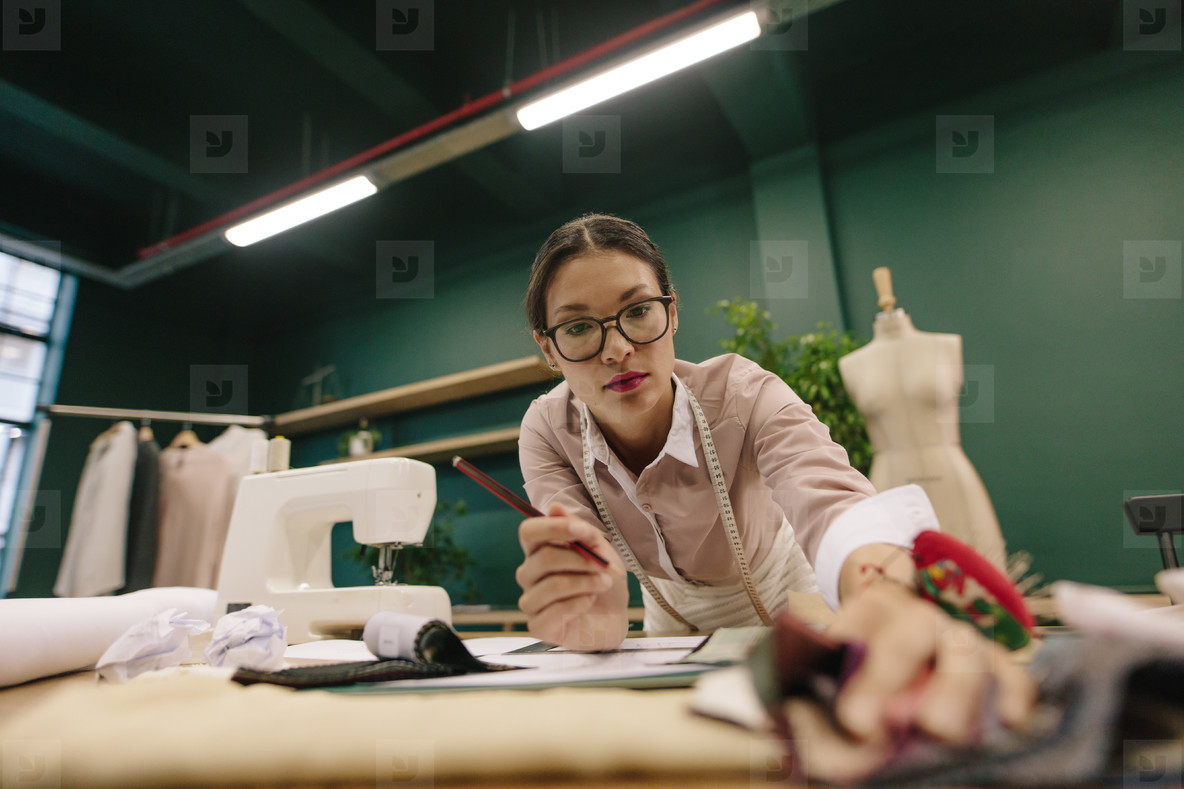 Female designer working in fashion studio