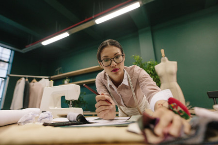 Female designer working in fashion studio