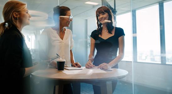 Corporate professional having an informal meeting in modern offi