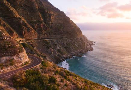 Landscape shot of road along the ocean