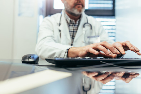 Medical professional using computer keyboard in clinic