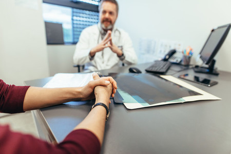Female visiting doctor for consultation
