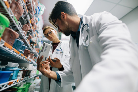 Two doctors working in hospital pharmacy