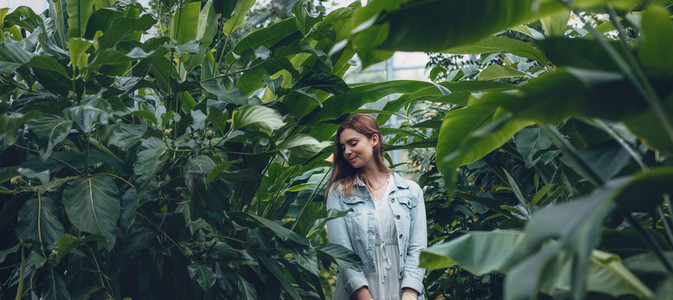 Woman standing in a greenhouse