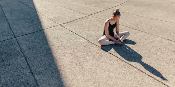 Female ballet dancer warming up before the practice