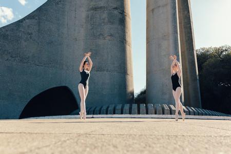 Female ballet dancers practicing a duet dance