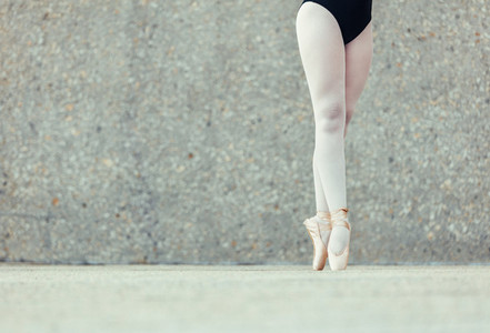 Close up of legs of ballet dancer standing on toes