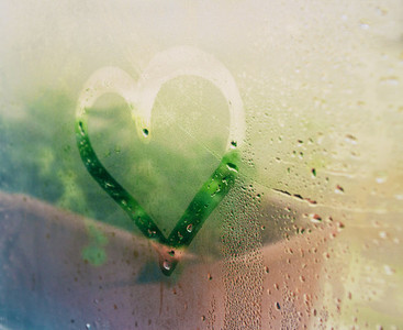 A heart drawing in a wet window