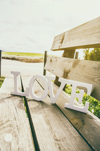 Word love over a bench