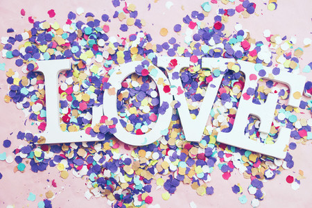 Love word and confetti