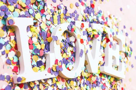Love word and confetti