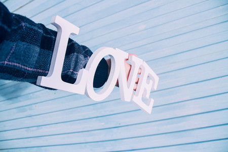 Word love and a blue background